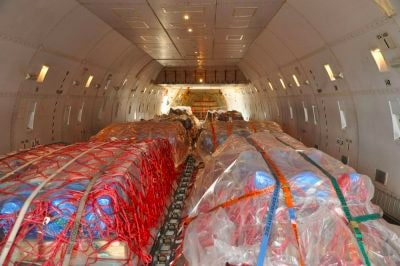 Pallets tied down in cargo plane for air freight transportation
