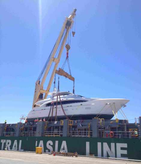 Luxury yacht being crane lifted in cradle
