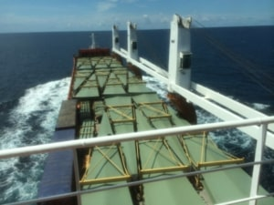 Freight container ship crossing ocean
