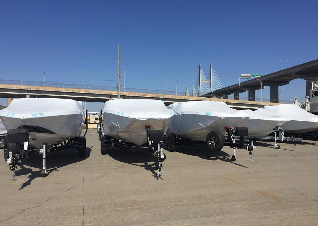 Five trailer boats wrapped ready for shipping