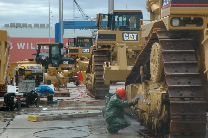 Cleaning Caterpillar mining machines at port