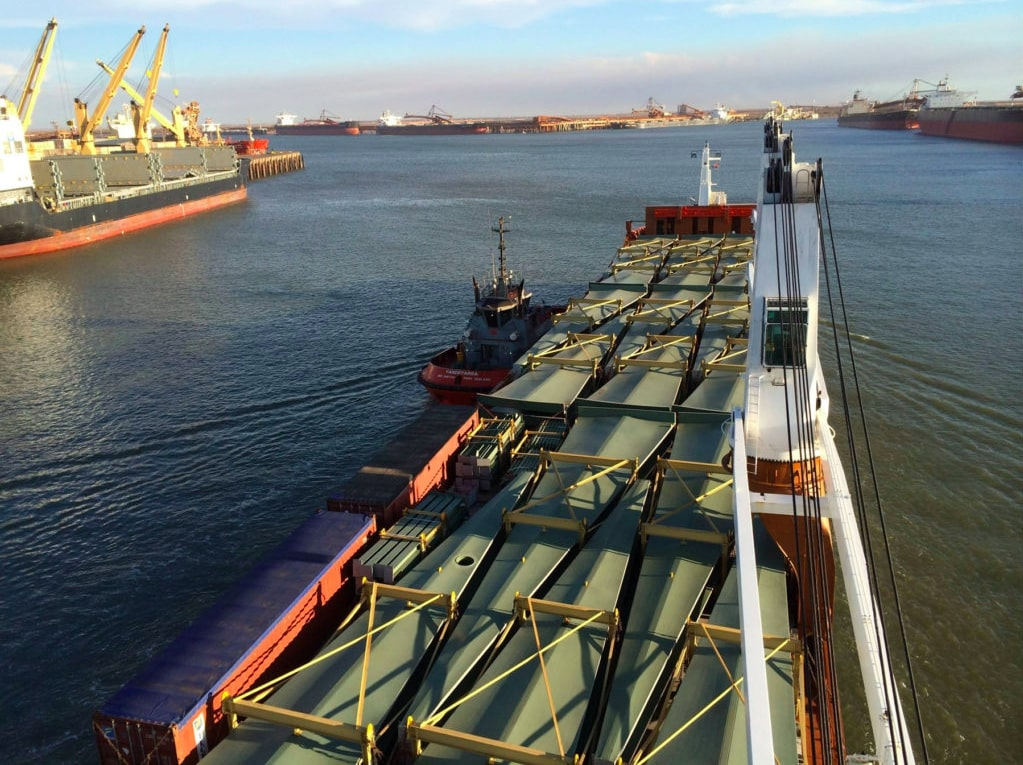 Vessel guided by pilot boat in port
