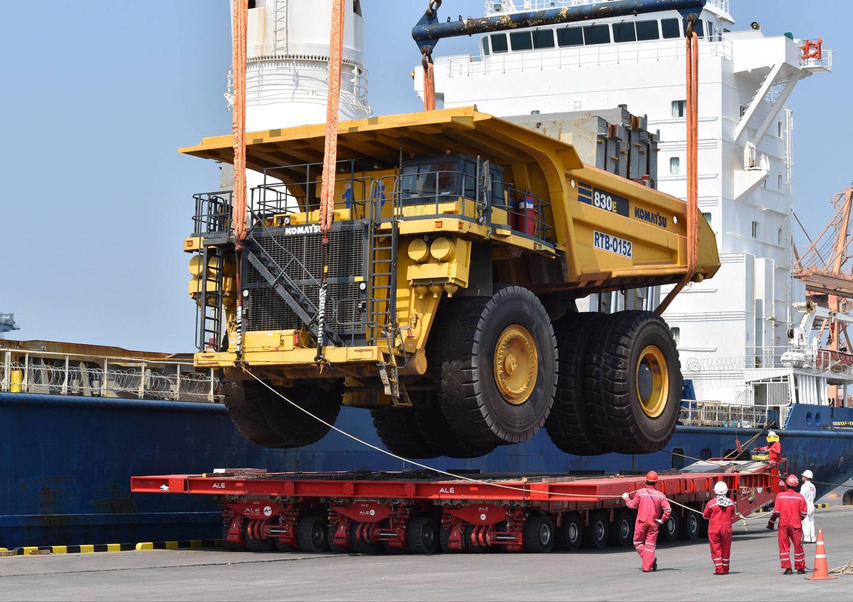Crane lowering a Komatsu 830E mining truck