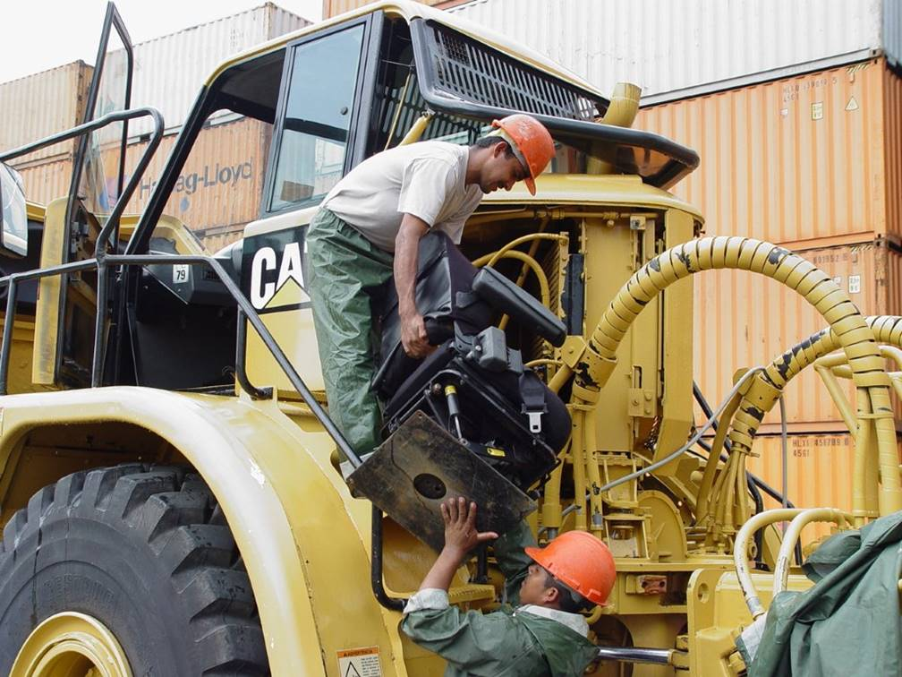 Dismantling Caterpillar machine in preparation for entry into Australia