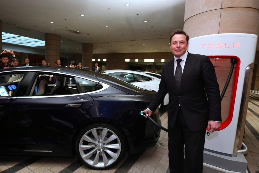 Tesla Motors Chief Executive Officer Elon Musk charges electric vehicle